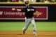 Jul 8, 2014; Phoenix, AZ, USA; Miami Marlins third baseman Casey McGehee (9) throws to first base during the fourth inning against the Arizona Diamondbacks at Chase Field. Mandatory Credit: Matt Kartozian-USA TODAY Sports