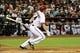 Jul 8, 2014; Phoenix, AZ, USA; Arizona Diamondbacks first baseman Paul Goldschmidt (44) hits a double during the seventh inning against the Miami Marlins at Chase Field. Mandatory Credit: Matt Kartozian-USA TODAY Sports