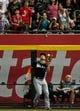 Jul 8, 2014; Phoenix, AZ, USA; Miami Marlins right fielder Giancarlo Stanton (27) catches a ball hit by Arizona Diamondbacks shortstop Cliff Pennington (4) to end the game and beat the Diamondbacks 2-1 at Chase Field. Mandatory Credit: Matt Kartozian-USA TODAY Sports