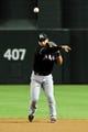 Jul 9, 2014; Phoenix, AZ, USA; Miami Marlins second baseman Donovan Solano (17) throws to first base during the third inning against the Arizona Diamondbacks at Chase Field. Mandatory Credit: Matt Kartozian-USA TODAY Sports
