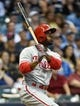 Jul 9, 2014; Milwaukee, WI, USA;  Philadelphia Phillies shortstop Jimmy Rollins (11) watches his 2-run home run in the sixth inning against the Milwaukee Brewers at Miller Park. The Phillies beat the Brewers 4-1. Mandatory Credit: Benny Sieu-USA TODAY Sports