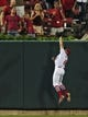 Jul 9, 2014; St. Louis, MO, USA; St. Louis Cardinals center fielder Peter Bourjos (8) catches a ball hit over the ball by Pittsburgh Pirates pinch hitter Russell Martin to rob a potential home run during the ninth inning at Busch Stadium. Cardinals defeated the Pirates 5-2. Mandatory Credit: Jeff Curry-USA TODAY Sports