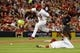 Jul 9, 2014; St. Louis, MO, USA; St. Louis Cardinals third baseman Matt Carpenter (13) leaps over starting pitcher Lance Lynn (31) during the seventh inning against the Pittsburgh Pirates at Busch Stadium. Cardinals defeated the Pirates 5-2. Mandatory Credit: Jeff Curry-USA TODAY Sports