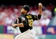 Jul 10, 2014; St. Louis, MO, USA; Pittsburgh Pirates starting pitcher Edinson Volquez (36) throws to a St. Louis Cardinals during the first inning at Busch Stadium. Mandatory Credit: Jeff Curry-USA TODAY Sports