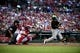 Jul 10, 2014; St. Louis, MO, USA; Pittsburgh Pirates catcher Russell Martin (55) hits a one run single off of St. Louis Cardinals starting pitcher Shelby Miller (not pictured) during the first inning at Busch Stadium. Mandatory Credit: Jeff Curry-USA TODAY Sports
