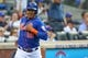 Jul 11, 2014; New York, NY, USA; New York Mets center fielder Juan Lagares (12) heads to the dugout after scoring on a single by shortstop Ruben Tejada (not pictured) during the second inning against the Miami Marlins at Citi Field. Mandatory Credit: Anthony Gruppuso-USA TODAY Sports
