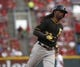 Jul 11, 2014; Cincinnati, OH, USA; Pittsburgh Pirates center fielder Andrew McCutchen rounds the bases after hitting a solo home run off Cincinnati Reds starting pitcher Mat Latos (not pictured) in the fourth inning at Great American Ball Park. Mandatory Credit: David Kohl-USA TODAY Sports