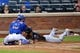 Jul 11, 2014; New York, NY, USA;  New York Mets catcher Travis d'Arnaud (15) has Miami Marlins second baseman Donovan Solano (17) out during the fourth inning at Citi Field. Mandatory Credit: Anthony Gruppuso-USA TODAY Sports