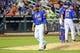 Jul 11, 2014; New York, NY, USA; New York Mets starting pitcher Zack Wheeler (45) heads to the dugout after being relieved during the seventh inning against the Miami Marlins at Citi Field. Mandatory Credit: Anthony Gruppuso-USA TODAY Sports