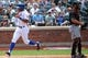 Jul 13, 2014; New York, NY, USA;  New York Mets left fielder Chris Young (1) crosses the plate to score during the fourth inning against the Miami Marlins at Citi Field. Mandatory Credit: Anthony Gruppuso-USA TODAY Sports