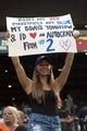 Jul 13, 2014; Baltimore, MD, USA; Megan Kibitlewski holds a sign up prior to the first inning of the game between the Baltimore Orioles and New York Yankees  at Oriole Park at Camden Yards. Mandatory Credit: Tommy Gilligan-USA TODAY Sports
