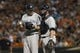 Jul 13, 2014; Baltimore, MD, USA; New York Yankees starting pitcher Chase Whitley (39) and catcher Brian McCann (34) speak on the mound during the second inning against the Baltimore Orioles at Oriole Park at Camden Yards. Mandatory Credit: Tommy Gilligan-USA TODAY Sports