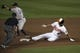 Jul 13, 2014; Baltimore, MD, USA; Baltimore Orioles shortstop J.J. Hardy (2) slides safely under New York Yankees second baseman Brian Roberts (14) tag for a double during the fourth inning at Oriole Park at Camden Yards. Mandatory Credit: Tommy Gilligan-USA TODAY Sports