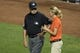 Jul 13, 2014; Baltimore, MD, USA; MLB umpire Jim Joyce (66) speaks with Baltimore Orioles heads ground keeper Nicole McFadyen behind the plate during the top of the fifth inning against the New York Yankees  Oriole Park at Camden Yards. Mandatory Credit: Tommy Gilligan-USA TODAY Sports