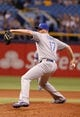 Jul 7, 2014; St. Petersburg, FL, USA; Kansas City Royals relief pitcher Wade Davis (17) throws a pitch against the Tampa Bay Rays at Tropicana Field. Mandatory Credit: Kim Klement-USA TODAY Sports