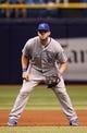 Jul 7, 2014; St. Petersburg, FL, USA; Kansas City Royals third baseman Mike Moustakas (8) against the Tampa Bay Rays at Tropicana Field. Mandatory Credit: Kim Klement-USA TODAY Sports
