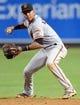 Jun 21, 2014; Phoenix, AZ, USA; San Francisco Giants second baseman Ehire Adrianza (6) throws to first base against the Arizona Diamondbacks at Chase Field. The Giants won 6-4. Mandatory Credit: Joe Camporeale-USA TODAY Sports