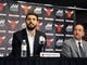 Jul 18, 2014; Chicago, IL, USA; Chicago Bulls new player Nikola Mirotic  (left) sits next to general manager Gar Forman during a press conference at the United Center. Mandatory Credit: David Banks-USA TODAY Sports