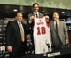 Jul 18, 2014; Chicago, IL, USA; Chicago Bulls head coach Tom Thibodeau (left) and general manager Gar Forman (right) pose for a photo with newly signed center Pau Gasol  during a press conference at the United Center. Mandatory Credit: David Banks-USA TODAY Sports