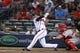 Jul 18, 2014; Atlanta, GA, USA; Atlanta Braves shortstop Andrelton Simmons (19) hits a RBI single against the Philadelphia Phillies in the second inning at Turner Field. Mandatory Credit: Brett Davis-USA TODAY Sports