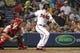 Jul 18, 2014; Atlanta, GA, USA; Atlanta Braves second baseman Tommy La Stella (7) hits a RBI single against the Philadelphia Phillies in the fifth inning at Turner Field. Mandatory Credit: Brett Davis-USA TODAY Sports