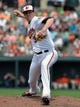 Jun 8, 2014; Baltimore, MD, USA; Baltimore Orioles relief pitcher Brad Brach (35) throws in the third inning against the Oakland Athletics at Oriole Park at Camden Yards. The Athletics defeated the Orioles 11-1. Mandatory Credit: Joy R. Absalon-USA TODAY Sports