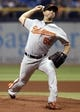 Jun 17, 2014; St. Petersburg, FL, USA; Baltimore Orioles starting pitcher Miguel Gonzalez (50) throws a pitch against the Tampa Bay Rays during the first inning at Tropicana Field. Mandatory Credit: Kim Klement-USA TODAY Sports