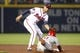 Jul 18, 2014; Atlanta, GA, USA; Atlanta Braves shortstop Andrelton Simmons (19) tags out Philadelphia Phillies shortstop Jimmy Rollins (11) in the eighth inning at Turner Field. Mandatory Credit: Brett Davis-USA TODAY Sports