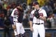 Jul 18, 2014; Atlanta, GA, USA; Atlanta Braves catcher Christian Bethancourt (25) and relief pitcher Craig Kimbrel (46) celebrate a victory against the Philadelphia Phillies in the ninth inning at Turner Field. The Braves defeated the Phillies 6-4.  Mandatory Credit: Brett Davis-USA TODAY Sports