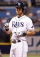 Jul 8, 2014; St. Petersburg, FL, USA; Tampa Bay Rays second baseman Ben Zobrist (18) points and reacts after he singled against the Kansas City Royals at Tropicana Field. Mandatory Credit: Kim Klement-USA TODAY Sports
