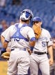 Jul 8, 2014; St. Petersburg, FL, USA; Kansas City Royals starting pitcher Jason Vargas (51) talks with catcher Salvador Perez (13) on the mound against the Tampa Bay Rays  at Tropicana Field. Mandatory Credit: Kim Klement-USA TODAY Sports