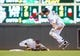 Jul 22, 2014; Minneapolis, MN, USA; Minnesota Twins first baseman Kendrys Morales (17) tries to avoid the tag by Cleveland Indians second baseman Jason Kipnis (22) in the seventh inning at Target Field. The Cleveland Indians win 8-2. Mandatory Credit: Brad Rempel-USA TODAY Sports