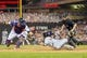 Jul 22, 2014; Minneapolis, MN, USA; Cleveland Indians second baseman Jason Kipnis (22) slides home safely in the ninth inning against the Minnesota Twins catcher Kurt Suzuki (8) at Target Field. The Cleveland Indians win 8-2. Mandatory Credit: Brad Rempel-USA TODAY Sports