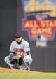 Jul 22, 2014; Minneapolis, MN, USA; Cleveland Indians first baseman Carlos Santana (41) watches the relief pitcher in the eighth inning against the Minnesota Twins at Target Field. The Cleveland Indians win 8-2. Mandatory Credit: Brad Rempel-USA TODAY Sports