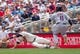 Jul 23, 2014; Minneapolis, MN, USA; Minnesota Twins second baseman Brian Dozier (2) makes a diving catch at first in the sixth inning against Cleveland Indians shortstop Jose Ramirez (11) at Target Field. Mandatory Credit: Brad Rempel-USA TODAY Sports