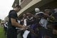Jul 24, 2014; Owings Mills, MD, USA;  Baltimore Ravens quarterback Joe Flacco (5) signs autographs for fans after practice at Under Armour Performance Center. Mandatory Credit: Tommy Gilligan-USA TODAY Sports