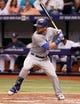 Jul 8, 2014; St. Petersburg, FL, USA; Kansas City Royals left fielder Alex Gordon (4) at bat against the Tampa Bay Rays at Tropicana Field. Mandatory Credit: Kim Klement-USA TODAY Sports