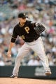 Jul 25, 2014; Denver, CO, USA; Pittsburgh Pirates starting pitcher Charlie Morton (50) delivers a pitch in the first inning against the Colorado Rockies at Coors Field. Mandatory Credit: Ron Chenoy-USA TODAY Sports