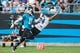 Jul 25, 2014; Charlotte, NC, USA; Carolina Panthers cornerback Josh Norman (24) tries to intercept an overthrown pass intended for wide receiver Tiquan Underwood (11) during training camp at Bank of America Stadium. Mandatory Credit: Jeremy Brevard-USA TODAY Sports