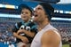 Jul 25, 2014; Charlotte, NC, USA; Carolina Panthers tight end Greg Olsen (88) holds his son Tate while talking to fans after the practice held at Bank of America Stadium. Mandatory Credit: Jeremy Brevard-USA TODAY Sports