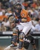 Jul 25, 2014; Houston, TX, USA; Houston Astros catcher Jason Castro (15) fields a throw for a force out at home during the eighth inning against the Miami Marlins at Minute Maid Park. Mandatory Credit: Troy Taormina-USA TODAY Sports