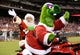 Jul 25, 2014; Philadelphia, PA, USA; The Phillie Phanatic gives Santa Claus a ride on his bike during Christmas in July at the ball park during a game against the Arizona Diamondbacks at at Citizens Bank Park. Mandatory Credit: Bill Streicher-USA TODAY Sports