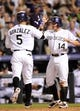 Jul 25, 2014; Denver, CO, USA; Colorado Rockies left fielder Carlos Gonzalez (5) is congratulated by second baseman Josh Rutledge (14) following his two run home run in the seventh inning against the Pittsburgh Pirates at Coors Field. Mandatory Credit: Ron Chenoy-USA TODAY Sports