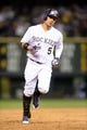 Jul 25, 2014; Denver, CO, USA; Colorado Rockies left fielder Carlos Gonzalez (5) rounds the bases after his two run home run in the seventh inning against the Pittsburgh Pirates at Coors Field. Mandatory Credit: Ron Chenoy-USA TODAY Sports