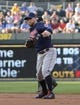 Jul 26, 2014; Kansas City, MO, USA; Cleveland Indians second baseman Jason Kipnis (22) fields a grounder against the Kansas City Royals in the second inning at Kauffman Stadium. Mandatory Credit: John Rieger-USA TODAY Sports