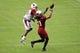 Jul 26, 2014; Tempe, AZ, USA; Arizona Cardinals wide receiver Larry Fitzgerald (11) misses a catch as cornerback Antonio Cromartie (31) defends during training camp at University of Phoenix. Mandatory Credit: Matt Kartozian-USA TODAY Sports