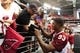 Jul 26, 2014; Tempe, AZ, USA; Arizona Cardinals defensive end Calais Campbell (93) signs autographs for fans during training camp at University of Phoenix. Mandatory Credit: Matt Kartozian-USA TODAY Sports