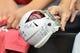 Jul 26, 2014; Tempe, AZ, USA; A fan holds a signed mini Arizona Cardinals helmet during training camp at University of Phoenix. Mandatory Credit: Matt Kartozian-USA TODAY Sports