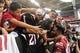 Jul 26, 2014; Tempe, AZ, USA; Arizona Cardinals defensive end Darnell Dockett (90) gets a hug from a fan during training camp at University of Phoenix. Mandatory Credit: Matt Kartozian-USA TODAY Sports