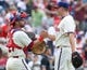 Jul 27, 2014; Philadelphia, PA, USA; Philadelphia Phillies catcher Wil Nieves (21) celebrates with relief pitcher Jonathan Papelbon (58) on his save at the end of a game against the Arizona Diamondbacks at Citizens Bank Park. The Phillies won 4-2. Mandatory Credit: Bill Streicher-USA TODAY Sports